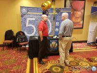 Vanguard Appraisals Regional Manager Mike Weeks talking with an IPAI Conference attendee.